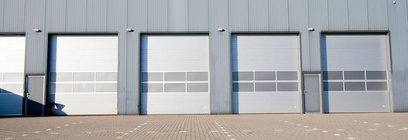 White Steel commercial roller shutters-in Perth